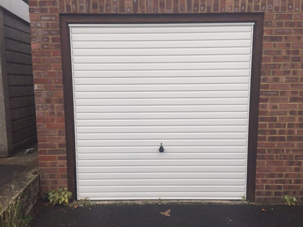 white Hormann up and over garage door fitted in Thame, Oxfordshire by Shutter Spec Security