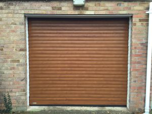 golden oak roller garage door fitted in haddenham by Shutter Spec Security