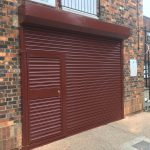 SeceuroDoor Commercial Shutter with Wicket Door installed in Knaphill, Buckinghamshire by Shutter Spec Security.
