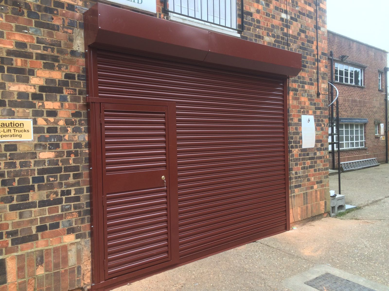 Seceurodoor Commercial Shutter With Wicket Door