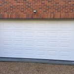 Georgian Sectional Garage Door installed in Gerrards Cross, Buckinghamshire by Shutter Spec Security.