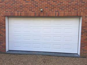 Georgian Sectional Garage Door installed in Gerrards Cross, Buckinghamshire by Shutter Spec Security.