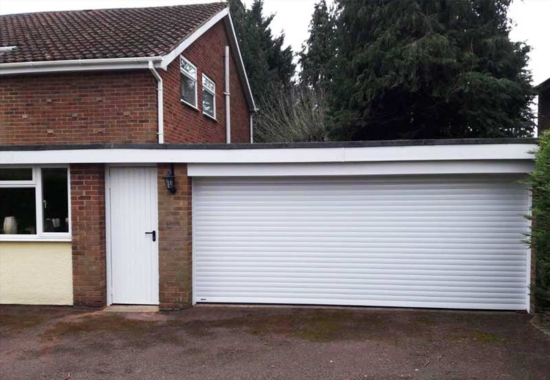 Seceuroglide Roller Garage Door and Garador Side Entrance Door Combination